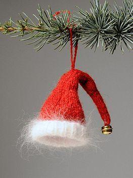 santa's hat pattern here http://www.knit-purl.com/store/pc/Elfin-Santa-Hat-Christmas-Ornament-Kit-244p4206.htm