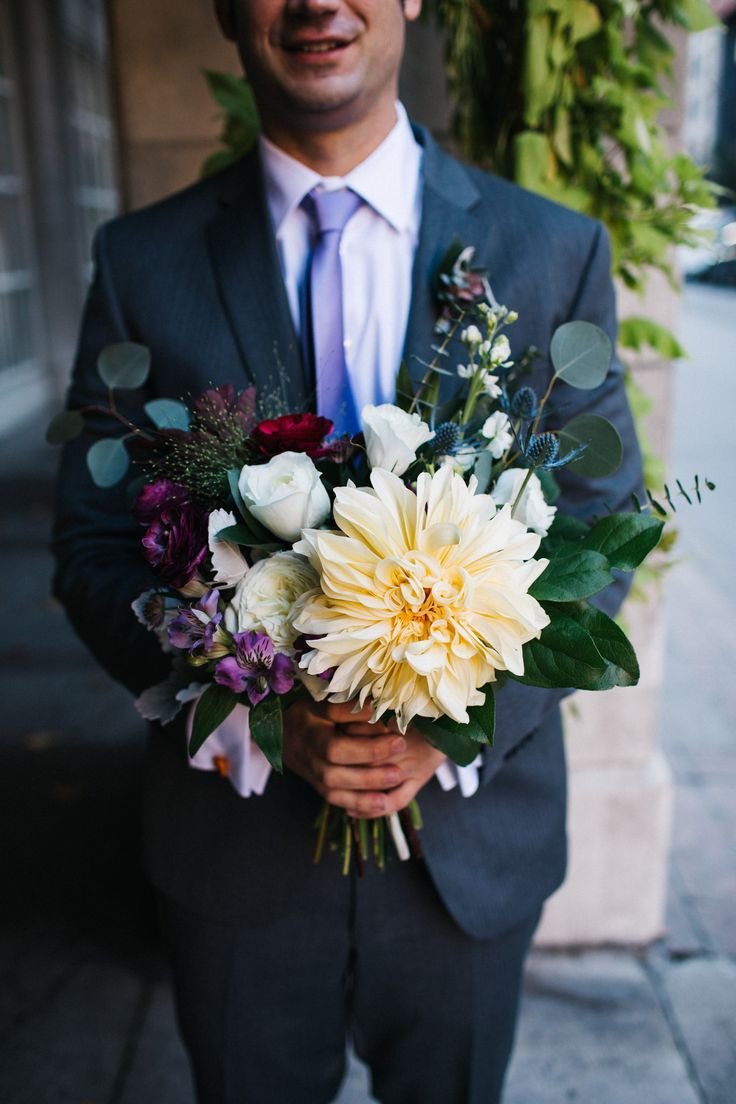 We love this groom's style and this gorgeous fall garden bouquet. Thompson Hotel Toronto Wedding Photographer Jennifer van Son Photography
