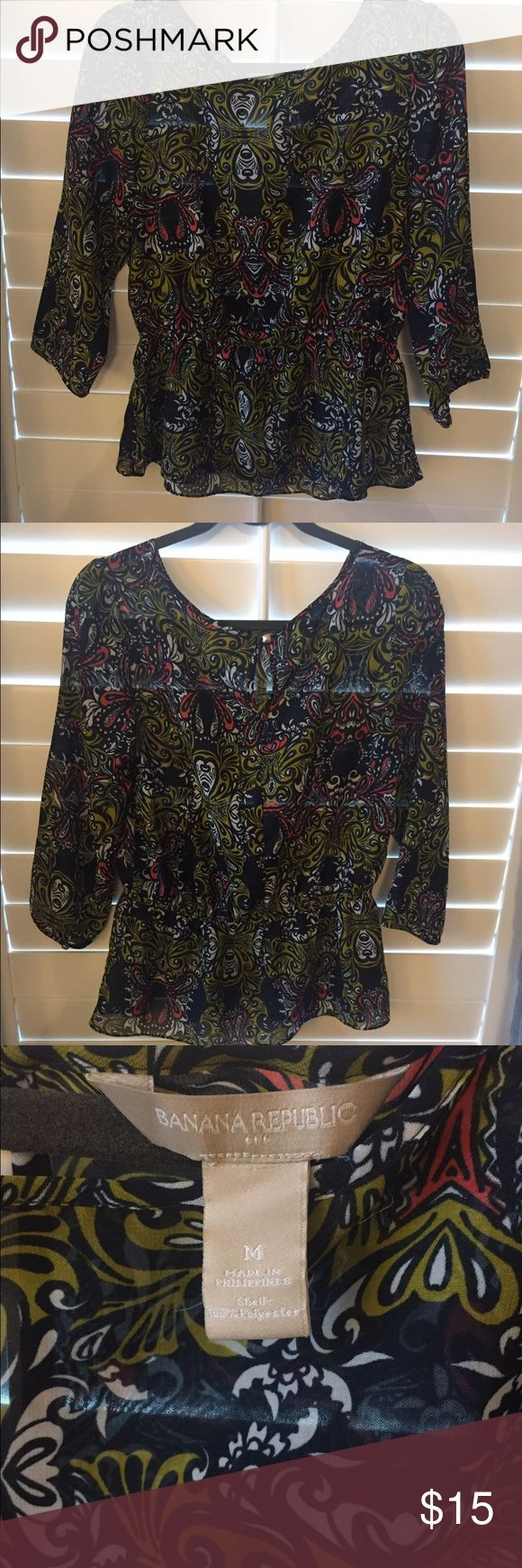Banana Republic Medium top Banana Republic tops- size medium. Navy, white, with hint of orange & yellow sheer top. Super cute with dress pants or jeans! Banana Republic Tops Blouses
