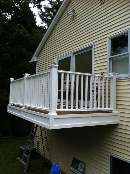 Cantilevered porch / deck / balcony from master bedroom. Trex decking, vinyl railings, faced with pvc trim.