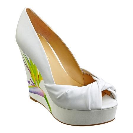 "Peep toe pump on 5"" wedge heel with 1 1/4"" platform."