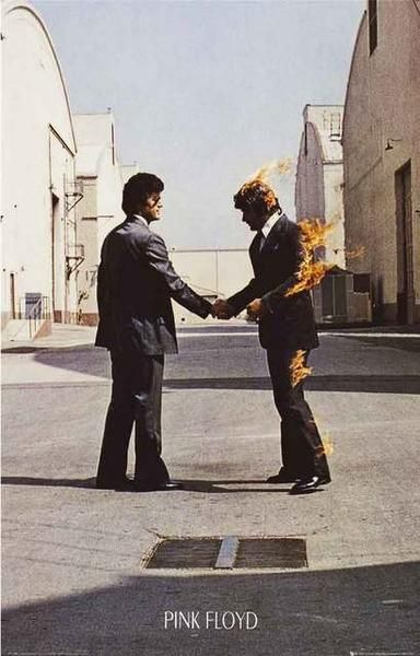 "A great poster of the enigmatic Hipgnosis album cover art from the Pink Floyd LP Wish You Were Here! Ships fast. 11x17 inches. Take some ""Time"" to check out the"