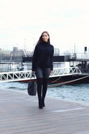 Emilie Tømmerberg wears thigh high boots in a simple, minimalistic style here - pairing them with leather leggings and a chic black polo neck sweater. Sweater: Selected Femme, Trousers: Zara, Bag: Michael Kors, Boots: Stuart Weitzman.