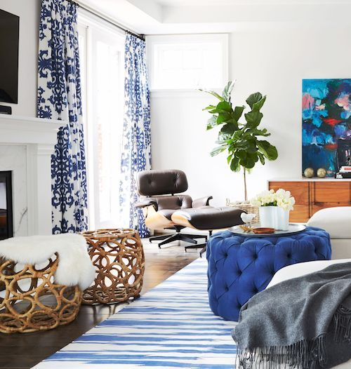 living room with blue accents blue accents like a tufted blue ottoman rug and printed 18654