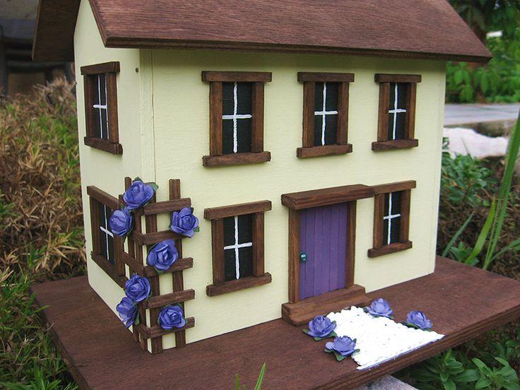 Házikók rózsalugassal