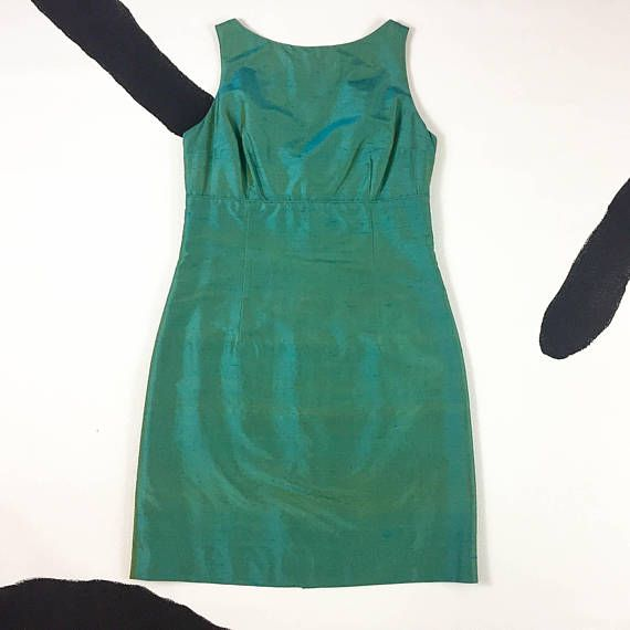 This is a lovely vintage 90s iridescent green party dress. It has the origial Cynthia Rowley label, made in the USA, excellent vintage condition. Marked a size 6. It measures: about 17 to 18 across the bust about 15 across the waist up to about 19 across at the hips about 33 total