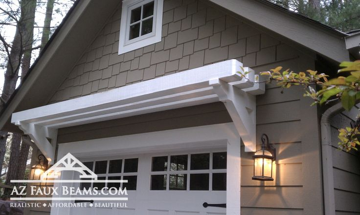 faux beams dress up this garage door area