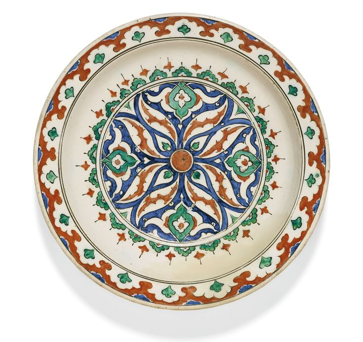 An Iznik polychrome pottery dish with burst flowerhead and arabesques, Turkey, second half 16th century | Lot | Sotheby's
