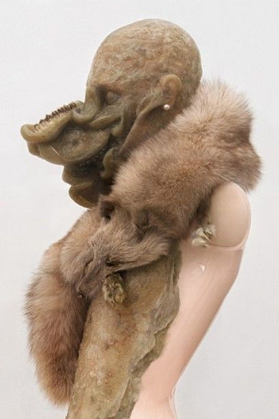 Aetiology Unknown 24 (detail), Jan Manski, 2012 / 190 x 60 x 60 cm (74 7/8 x 23 5/8 x 23 5/8 in) . Fat, leather, fur, mannequin, jaws, enamel cosmetics, earrings, polyvinyl acetate, vitrine. Photo janmanski.com