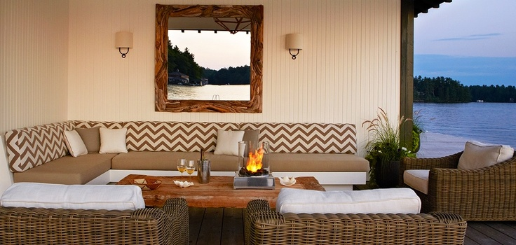 A table top firepit can transform a porch space and help you create an amazing place to sit with friends, just like Anne Hepfer Designs created.