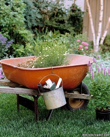 Clean-Up Bucket - Streamline your round of gardening chores by sorting debris as you go. Throw biodegradable waste into a wheelbarrow, ready to dump on the compost heap when you're finished. Keep other yard trash -- labels, broken pots, and rocks, for example -- separate in a bucket hung over the barrow's edge with a large S hook.