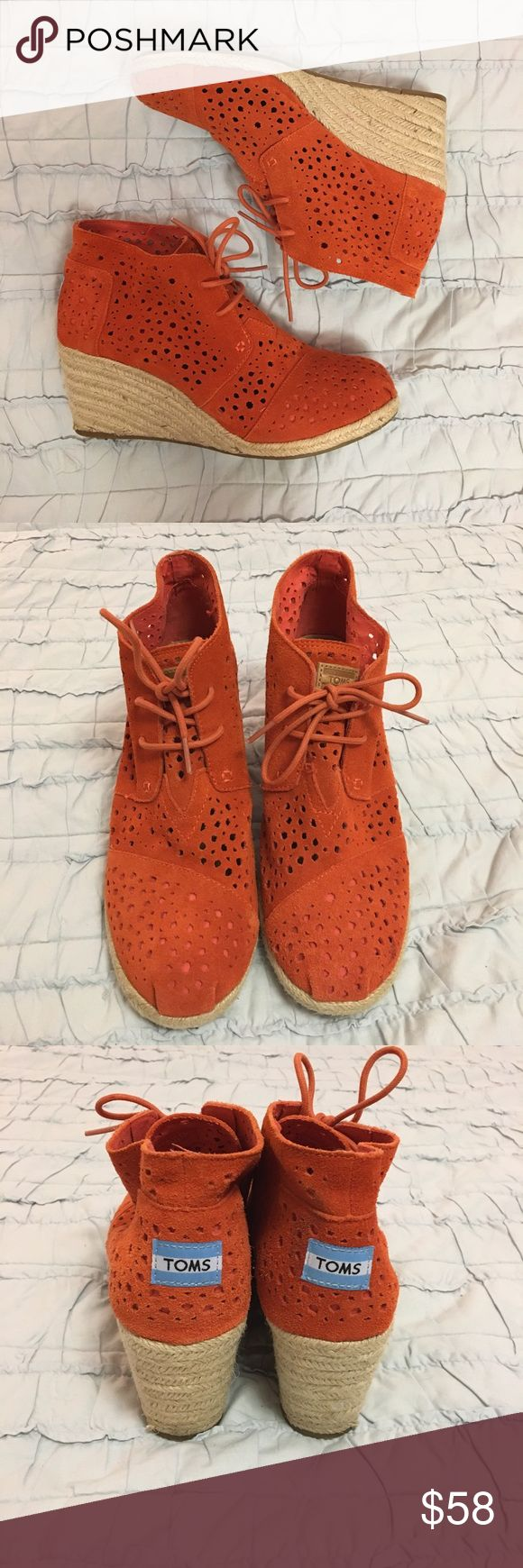 """TOMS Moroccan Cutout Espadrille Wedge Orange suede cut out bootie wedges. Perforated suede upper with tonal topstitching. Ankle-high shaft; 2 3/4"""" braided jute wedge heel. Rubber and jute sole provides traction. Excellent condition. Worn once! Size 9. So comfortable!! TOMS Shoes Wedges"""