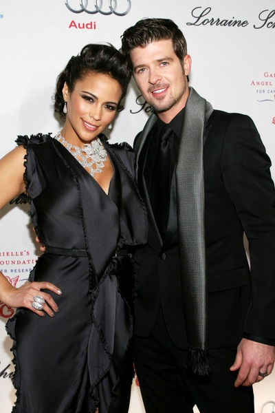 Awwwww man they are such a cute couple...Robin Thicke and Paula Patton