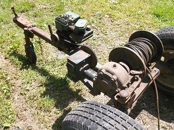 Portable Motorized Winch by Dawai -- Homemade portable motorized winch constructed from an electric motor, gearboxes, a spool, a lawnmower governor, a trailer frame, and wheels. http://www.homemadetools.net/homemade-portable-motorized-winch