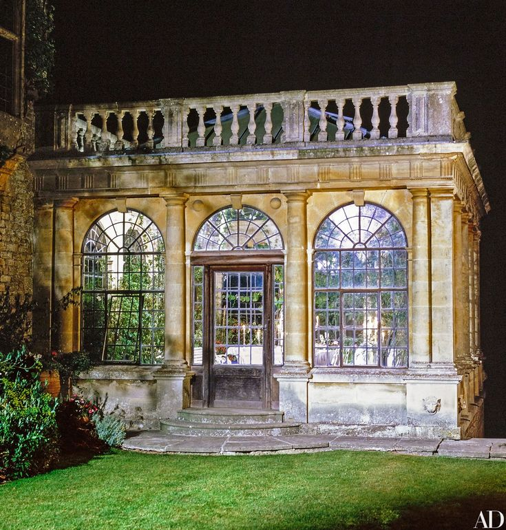 """At night, the Neoclassical design of the orangery is enhanced by spotlights. """"The passion-flower plant had been completely neglected,"""" says Jane Seymour. """"We cut it back, watered it, and now it's almost taken over."""""""