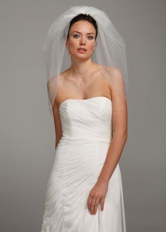"The Bubble Veil is the hot new accessory every bride should have on her special day! We call this the bubble veil because it's short and fun! If you are looking for a chic yet no-fuss veil, this is the perfect one for you!  Veil features two layers that give it extra volume and are added to the comb, creating a full and beautiful look.  Measures 22""L x 72""W.  Fabric Content: Nylon Tulle.  To care for your veil, hang and steam.  Imported. $39.99 ( on sale $69.99 )"