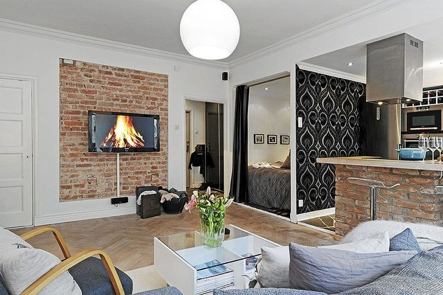 Studio avec briques apparentes pour un appartement de caractère