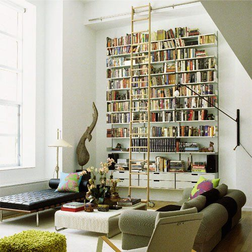LOVE - Could DIY shelving from hardware store good idea for high ceiling large wall