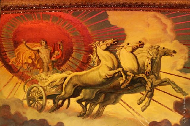 Hélios -  é a personificação do Sol na mitologia grega. Hélio é filho dos titãs Hiperião e Teia,  sua cabeça é coroada por uma auréola solar. Circula a terra com a carruagem do sol atravessando o céu para chegar, à noite, ao oceano onde os seus cavalos se banham. Nada do que se passa no universo escapa ao seu olhar, sendo frequentemente convocado por outros deuses para servir como testemunha.