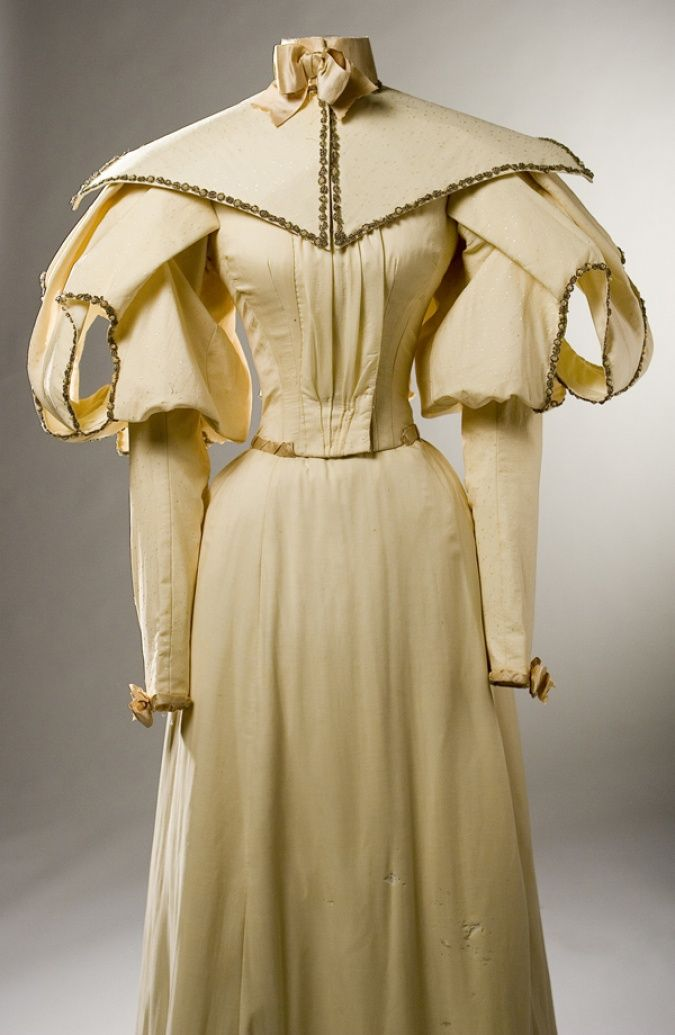 fripperiesandfobs:  Wedding dress, 1895 From the Missouri History Museum  These open sleeves are so interesting!