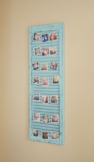 Super cute idea for a picture display on a distressed window shutter!