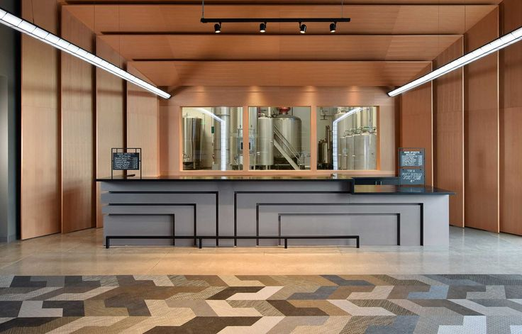 Beautiful floor covering using Bolon Studio™ Wings in the lobby at the House Of Spirits distillery in Portland, OR