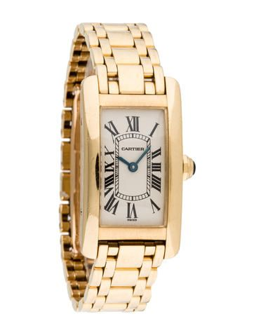 Ladies' 18K yellow gold 35x19mm Cartier Tank Américaine watch with smooth bezel, creme dial, black Roman numeral hour markers, blued steel hands, 18K yellow gold link bracelet and double deployant closure.  Note: This watch has been evaluated by our Watch Specialist and Horologist.   Watch Condition: Grade 2 Collection: Tank Model Name: Tank Americaine Reference Number: W26015K2 Serial Number: BB***** Movement: Quartz Battery Operated  Case Shape: Rectangle  Case Material: 18K Yellow Gold…