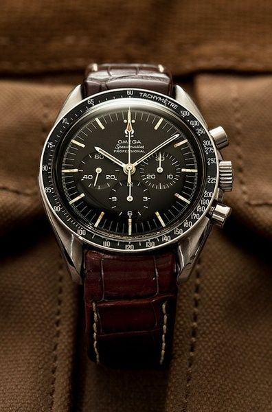 Omega Speedmaster with leather band. re-pinned by http://www.cooganlondon.com