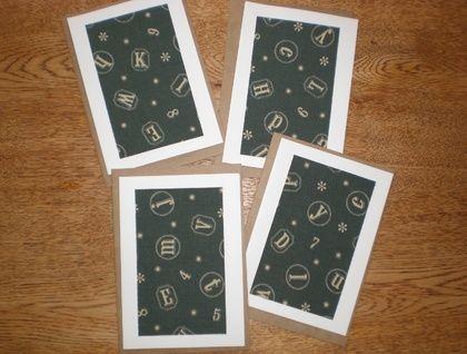 Four fabric notecards