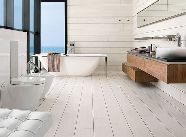 Coastal bathroom with stripes woods as the floor and wall and blues beach view door