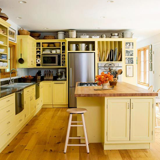 We love the bright cabinets and butcher block countertops in this space. See more countertop materials: http://www.bhg.com/kitchen/countertop/top-10-countertop-materials/