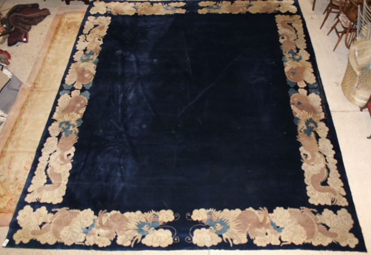 """Lot 894, A good quality 1920's Chinese blue ground rug with dragon border 175"""" x 150"""", sold for £2,800"""