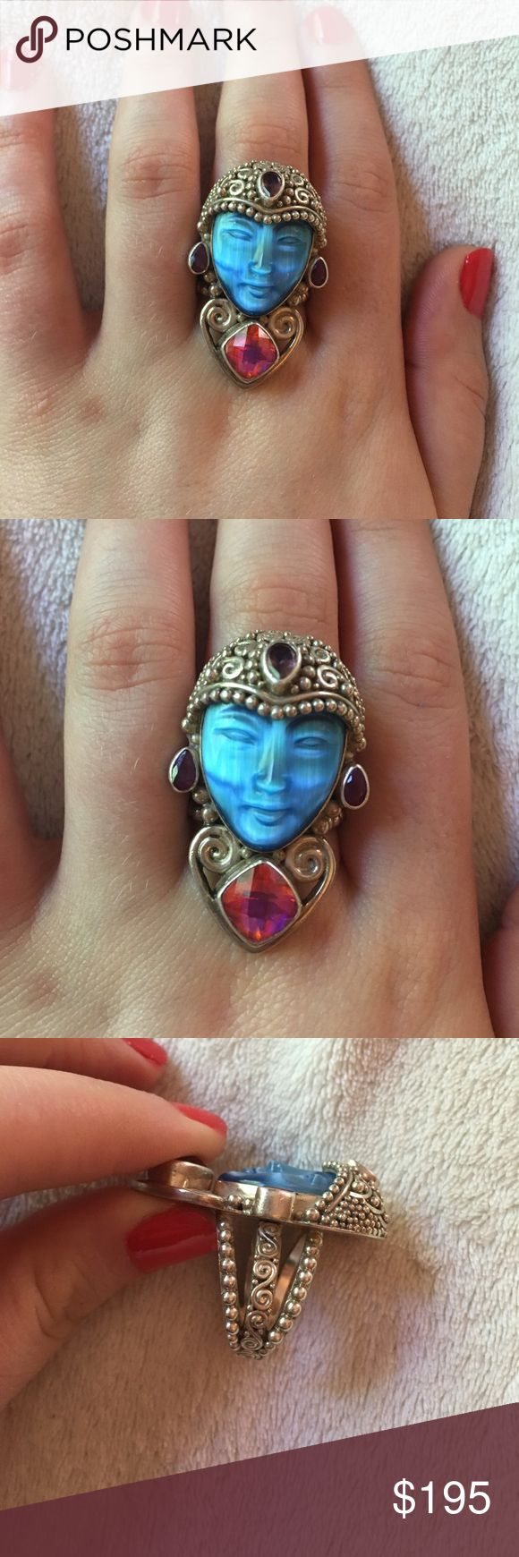 Sterling silver .925 moon stone goddess head ring Very gently worn. This is a sterling silver .925 stamped moonstone ring. Artist signed Sajen . Accented with purple amethyst and mystic topaz. Very rare. The face of the goddess is hand carved ... PRICE FIRM. Size 8. Adjustable. Jewelry Rings