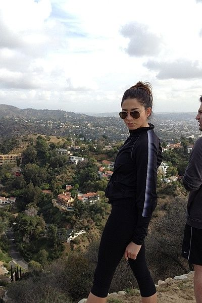 """""""Hiking — Ray Ban sunnies. Stella McCartney jacket. Black leggings are [from] Z."""""""