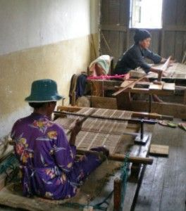Sahalandy weaver in process of making a silk shawl on a traditional floor loom. Federation Sahalandy is just one of a number of cooperatives who have joined together in the spinning and weaving of a cloth that is the tradition of the Malagasy culture. | Clothroads