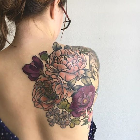 Large floral upper back tattoo by D'Lacie Jeanne. #flower #floral #botanical #D'LacieJeanne #neotraditional