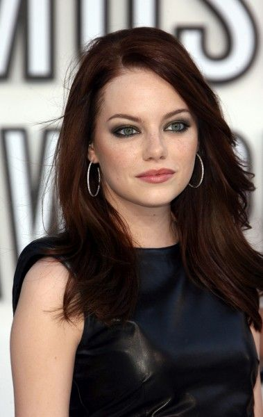 Really like that hair color. It's just barely red. The cut's not bad either.  Emma Stone - dark red hair