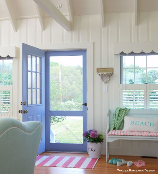 Summer Beach Cottage | Tracey Rapisardi Style. Different size knotty pine boards added to walls make for a summer cottage vibe. The door in periwinkle pops. Wood valances add whimsy. Wood shutters privy as wanted.