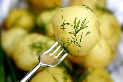 New potatoes with dill and butter. And maybe smoked whitefish or salmon. The best summer food!