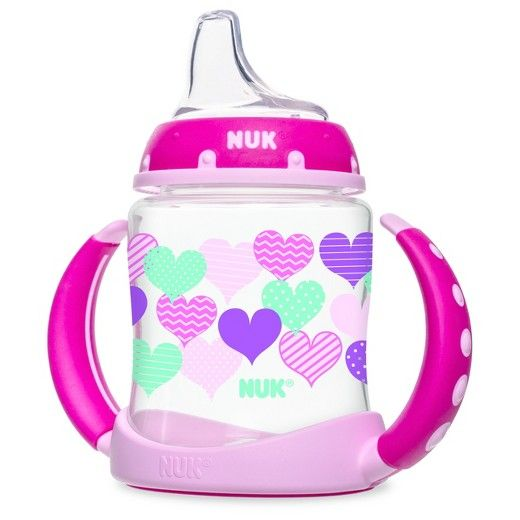 The NUK® Fashion Learner Cup will help your baby transition to a sippy cup in style. NUK® Learner Cups are designed to help transition your baby from breast or bottle to cup easier. The spill-proof, soft spout is designed to be gentle on gums while teaching baby to drink from a spout. The removable anti-slip, easy-grip handles fit comfortably into your little ones hands and once removed, fits most cup holders! Every learner cup spout includes an air vent that helps reduce sw...