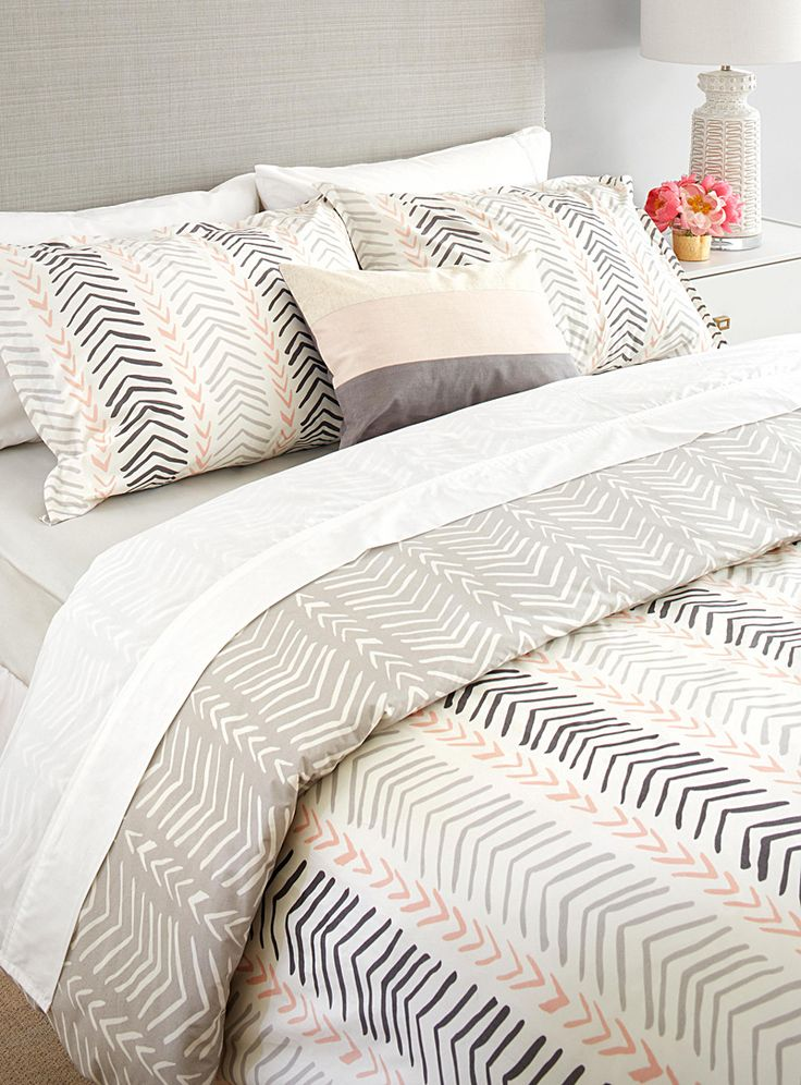A design by Samantha Pynn exclusively for Simons Maison Samantha's relaxed and modern interpretation of a designer classic makes a stylish statement. One side of this reversible duvet cover is an easy neutral in grey and white, while the other shows a pretty-in-pink combo of charcoal and grey with blush. The set includes: Twin: 1 duvet cover 66&quote; x 90&quote;, 1 pillow sham 20&quote; x 26&quote; Double: 1 duvet cover 84&quote; x 90&quote;, 2 pillow shams 20&am...