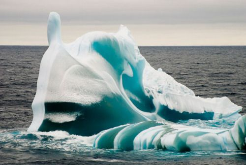 A combination of light and frozen sea water gives a greenish tinge to an iceberg in the waters between Australia's Casey and Davis bases in Antarctica.