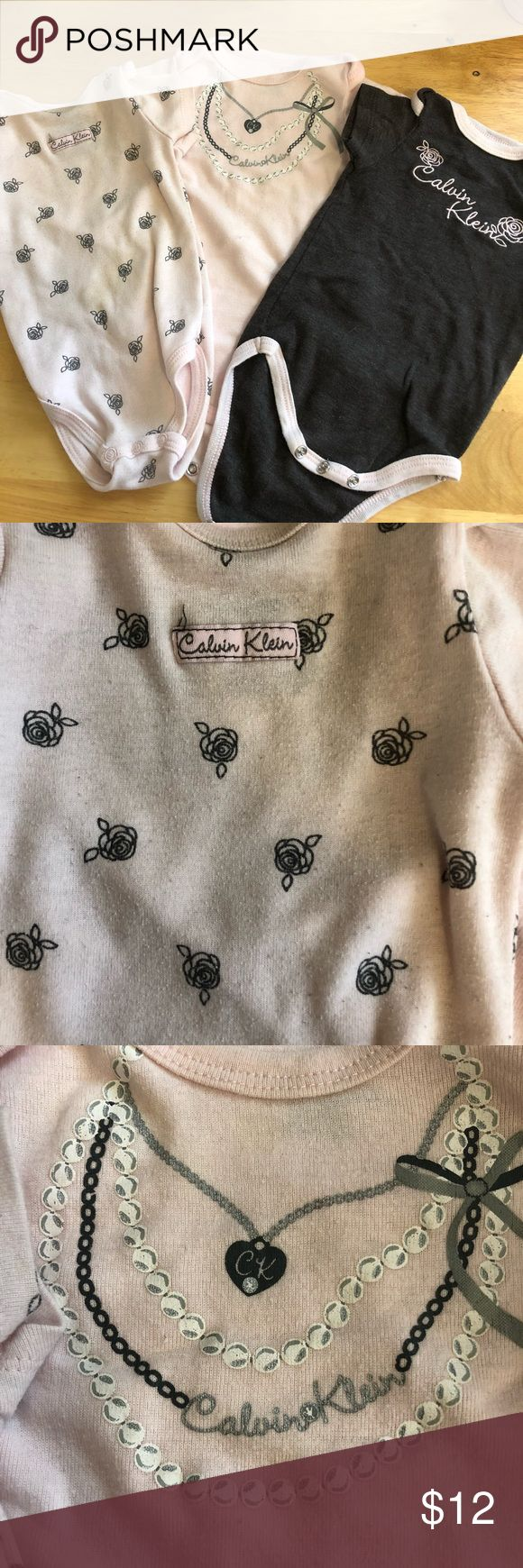 Calvin Klein 3-6 month baby girl bundle Baby girl clothes size 3-6 month  Calvin Klein brand  3 onesies  2 outfits with shirt and skirt/pants  No stains  Pet/smoke free home Calvin Klein Matching Sets