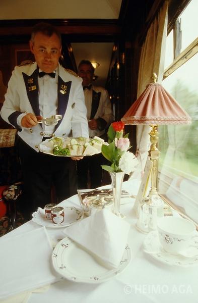 Venice Simplon-Orient-Express. Chief steward Robert Birch serving afternoon tea in the Pullman Train between Folkestone and London.