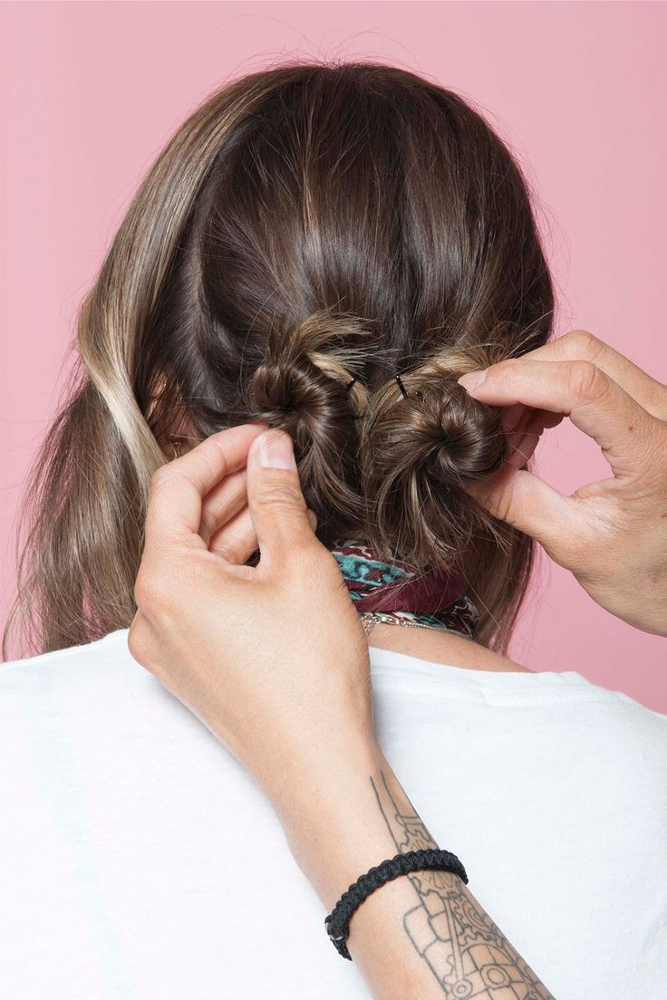 How To Style L.A.'s Most Popular Haircut 3 Ways In 3 Days  #refinery29  http://www.refinery29.com/anh-co-tran-layered-long-bob#slide-19  Repeat on the next section, creating a bun right next to the first one.