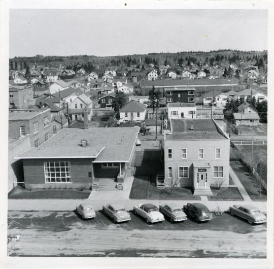 The Parsons Clinic building and the old RCMP station/Public Library building north of City Hall on Ross Street, c. 1954.