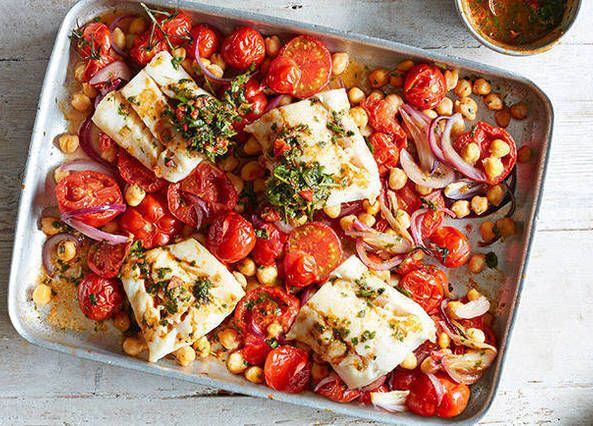 Spice up your seafood supper with this simple traybake recipe. Cod, chickpeas and tomatoes are baked together until tender and dressed in a spicy chermoula mix