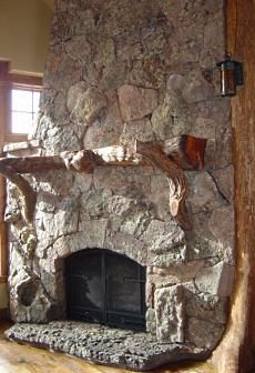 gnarled wood mantel shelf resting naturally formed wooden brackets stone fireplace for stove design with touch
