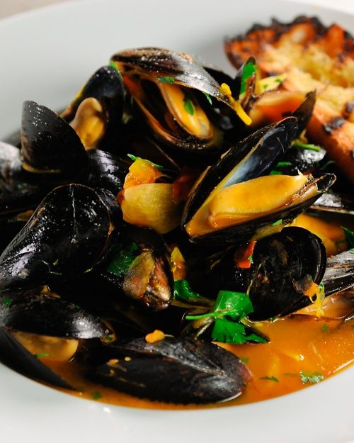STEAMED MUSSELS WITH WINE AND SAFFRON - Martha Stewart Recipes.  Incredibly delicious!