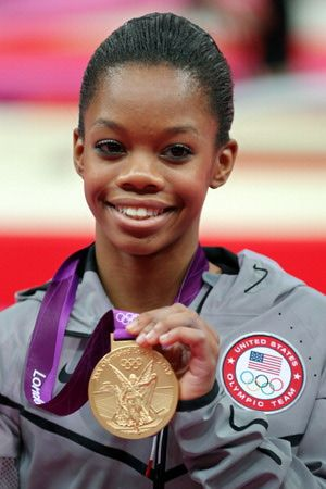 Gorgeous shots of Olympic champion Gabby Douglas' career: 2012 Olympics: All-Around Finals